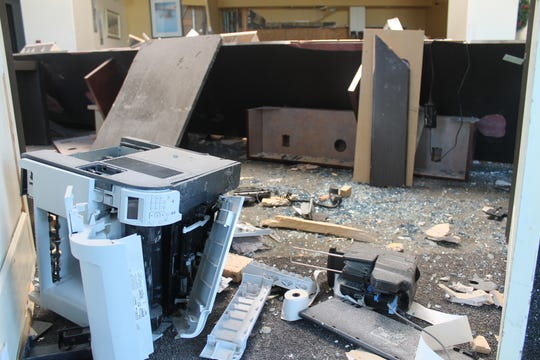 Equipment and machinery is scattered inside Washington Federal Bank after a truck drove through an exterior wall and into the bank on Nov. 25.