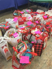 The gift bags handed out by Sal Lopez and helpers at Christmas were decorated to bring smiles