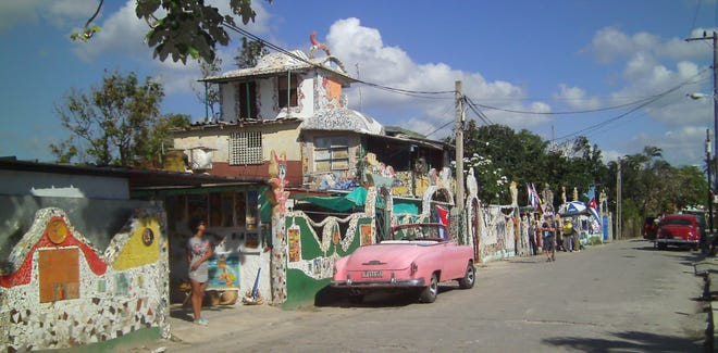 In Fursterlandia, colorful tile art by José Fuster decorates the entire neighborhood. The vintage 1954 pink Chevy convertible fits right in.