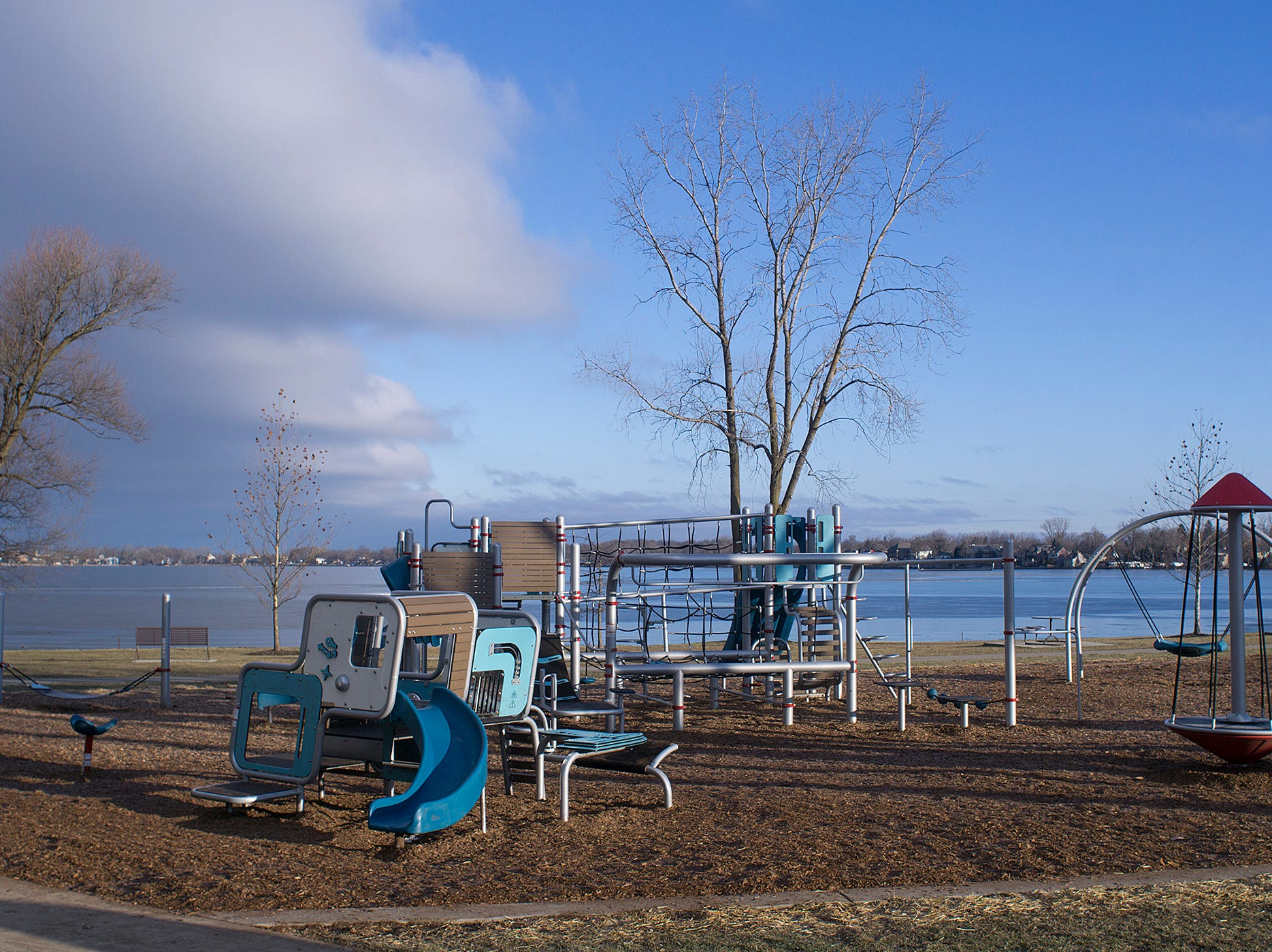 New playground equipment on the shore of Walled Lake.
