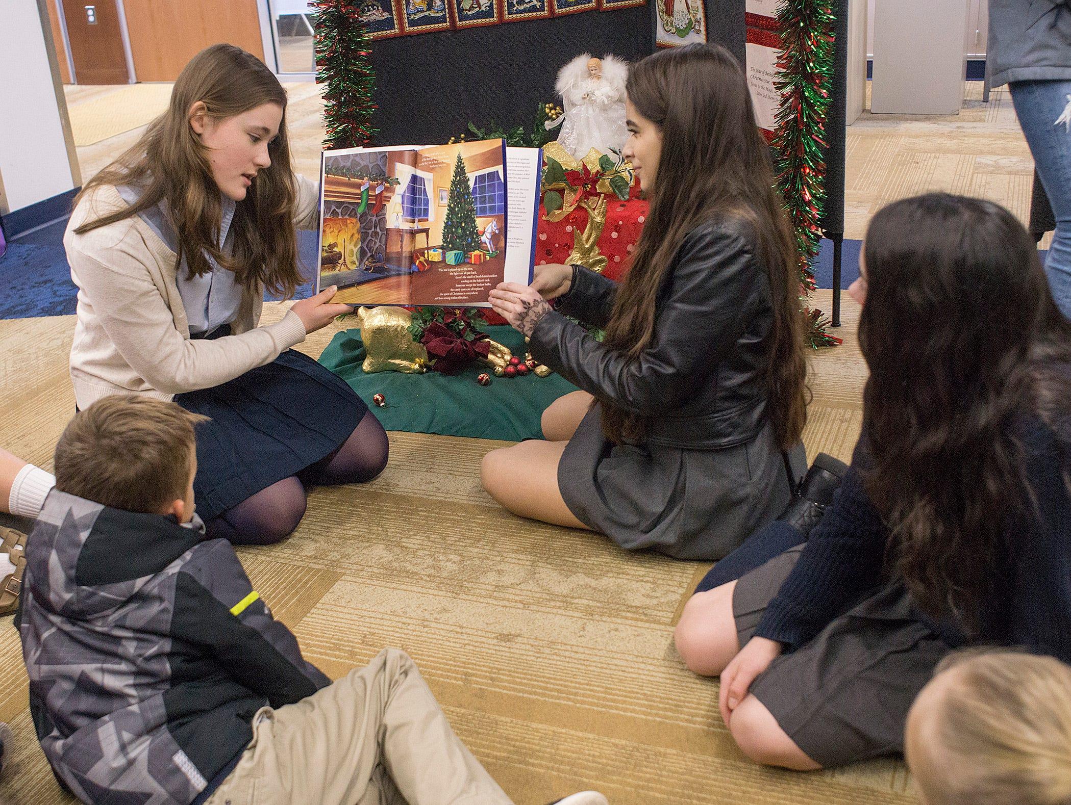 Clara Yuhn, Nikol Uribe Guiza, and Erin Brennan teach Christmas traditions.