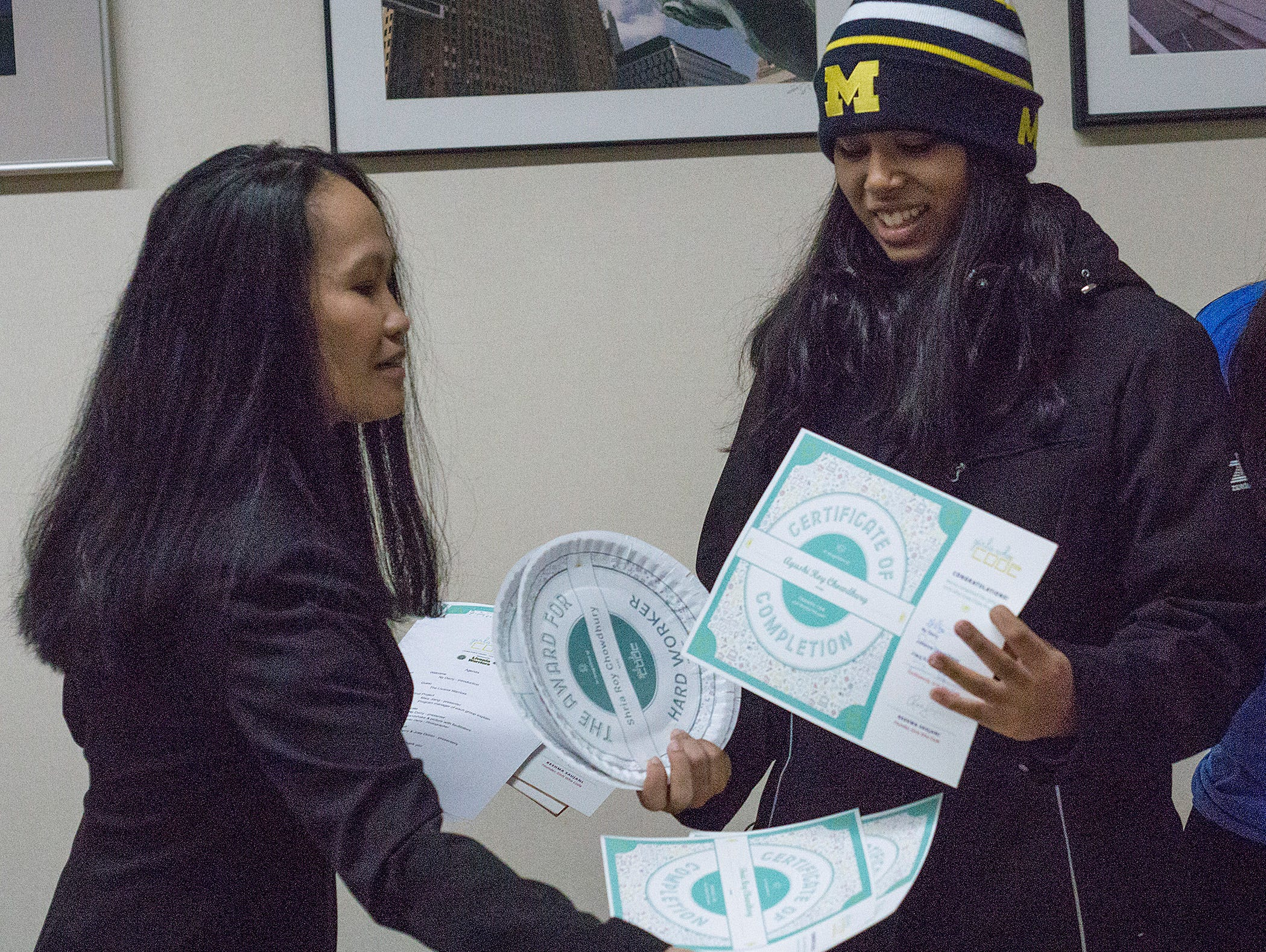 NY Derry presents awards to Ayushi Chowdhurry, a student at International Academy in Troy.