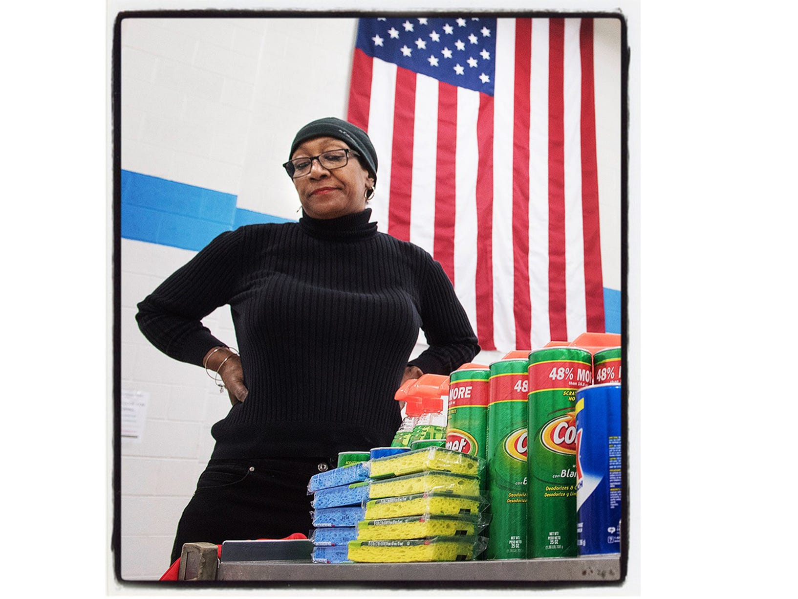Volunteer Gail Monk takes a moment for a break before delivering more cleaning supplies to students packing for St John Lutheran School's veterans project. Westland, Michigan.