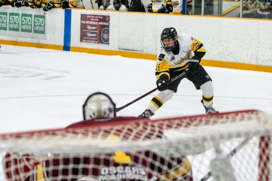 Plymouth High School alum Jack Chumley takes aim at an opposing goalie during a recent game. Chumley is playing for Waterloo of the Greater Ontario Junior Hockey League.