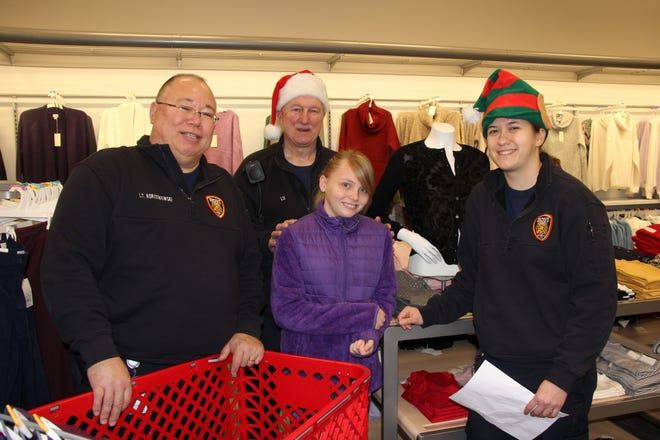 Novi Fire Lt. Carl Korzeniowski (left), firefighters Greg Lis, and Abigail Scrivner at the Novi Shop with a Hero held at Target.