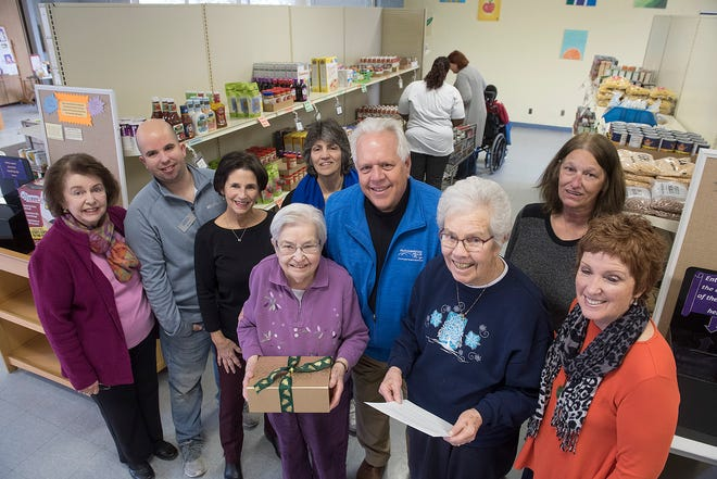 Here's the crowd who showed up for the donation from the sisters. From left, Nadine Maynard, Kevin Ostach, Kittie Ostach, Lori Breen, Sister Mary Joel, Todd Lipa, Sister Camille Kelley, Delores Watters, and Elaine Grohman.
