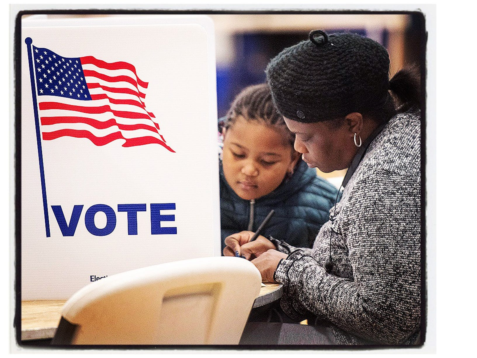 LaShawn Strickland and 5 year old granddaughter Kindall Westbrook, voting in Canton Township precinct 27, located at The Summit on the Park.