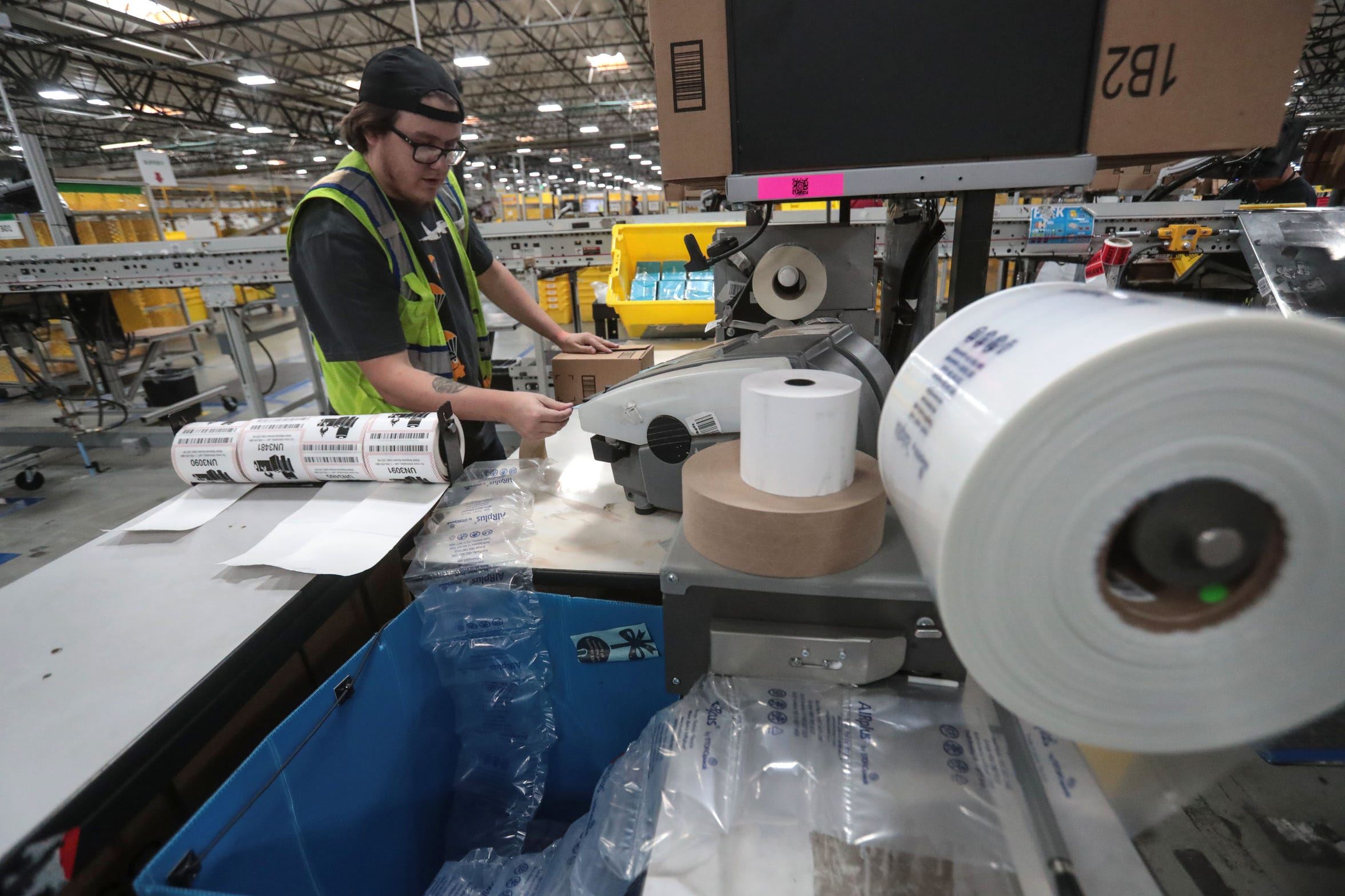 Trainer, Cody Glenney packages orders for shipping at the  Amazon Fulfillment Center in Moreno Valley on Thursday, December 13, 2018.