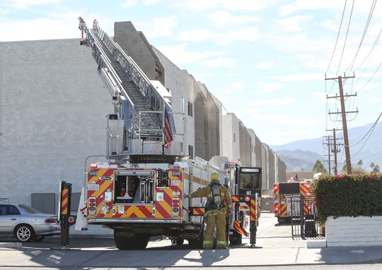 Firefighters respond to a fire at The Modern Cactus apartment buildings in Palm Springs, December 18, 2018.