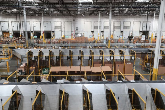 Conveyor belts move items around the Amazon Fulfillment Center in Moreno Valley before shipping on Thursday, December 13, 2018.
