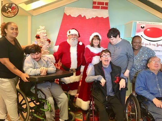 Students from Capstone Adaptive Learning & Therapy Centerspose with Santa during a pancake event sponsored by Cordova Rotary at Gulf Coast Kid's House.