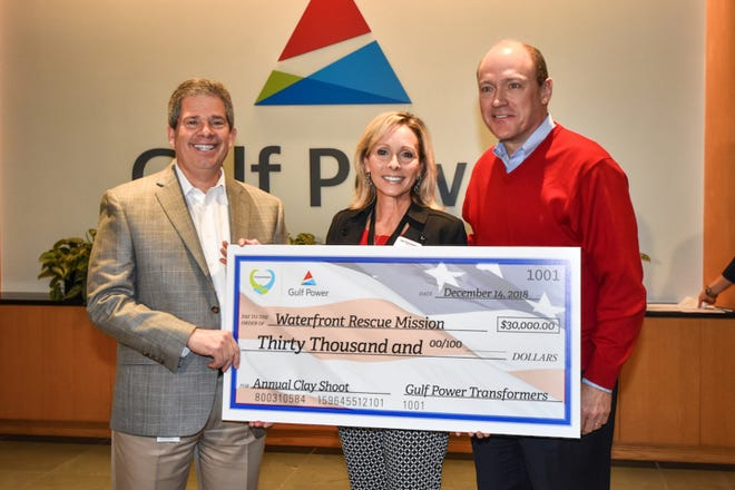 Gulf Power presents a $30,000 check to the Waterfront Rescue Mission for its programs to assist veterans. Two other Panhandle organizations each received $30,000.