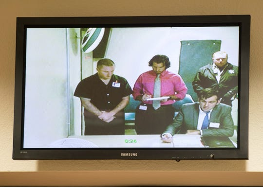 Former Santa Rosa County Sheriff's Office deputy Jeffery Perkins, left, makes his first appearance Dec. 18  before Judge Joyce Williams via video at the Escambia County Courthouse in Pensacola.