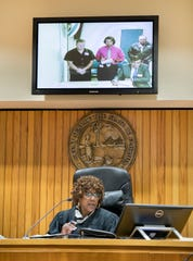 Santa Rosa County Sheriff's Office deputy Jeffery Perkins, top left, makes his first appearance before Judge Joyce Williams in video court at the Escambia County Courthouse in Pensacola on Tuesday, December 18, 2018.