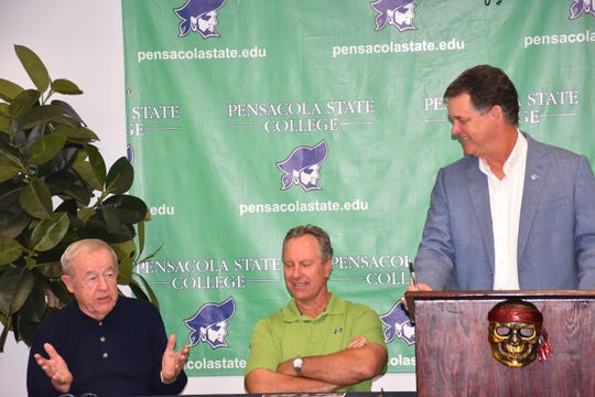 Pensacola State athletic director Bill Hamilton (at podium) shares laugh with Jim Donvan (far left) and Greg Litton during Monday's announcement of the inaugural PSC Athletic Hall of Fame class.