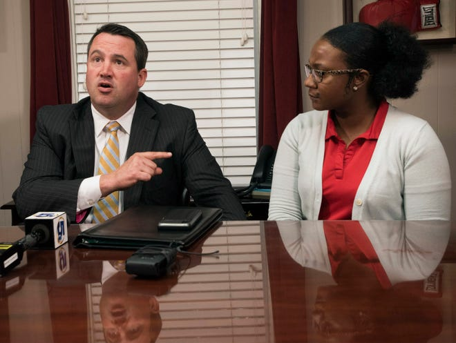 Attorney Christopher Marlowe announces he has filed a wrongful death lawsuit against Aspen Village Acquisition and Progressive Management of America on behalf of his client, Shantara Hurry, the mother of Naomi Jones, during a press conference on Tuesday.