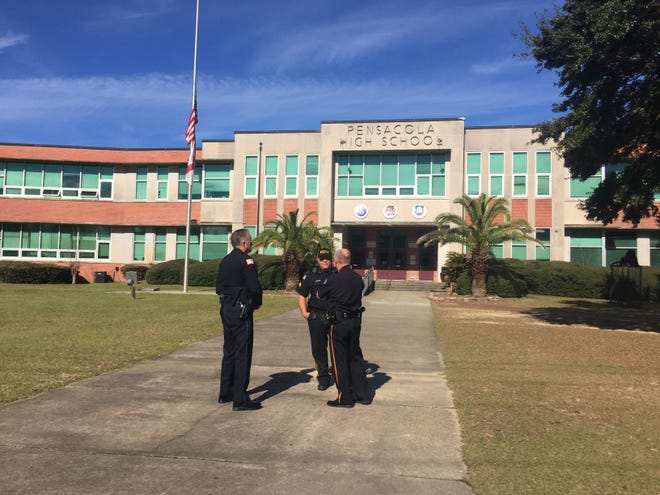 Law enforcement officers investigate a bomb threat at Pensacola High School on Tuesday, Dec. 18, 2018.