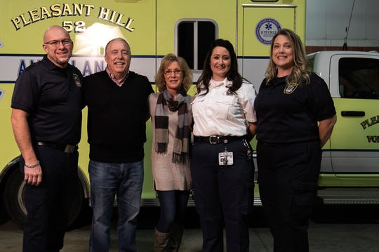 From left, EMT TJ Fryman, cardiac survivor Steve Harmon and his wife Sandy Harmon, PHRN Patricia Webb and EMT Kristy Fryman pose for a photo at the Pleasant Hill Volunteer Fire Company Station, Monday, Dec. 3, 2018.