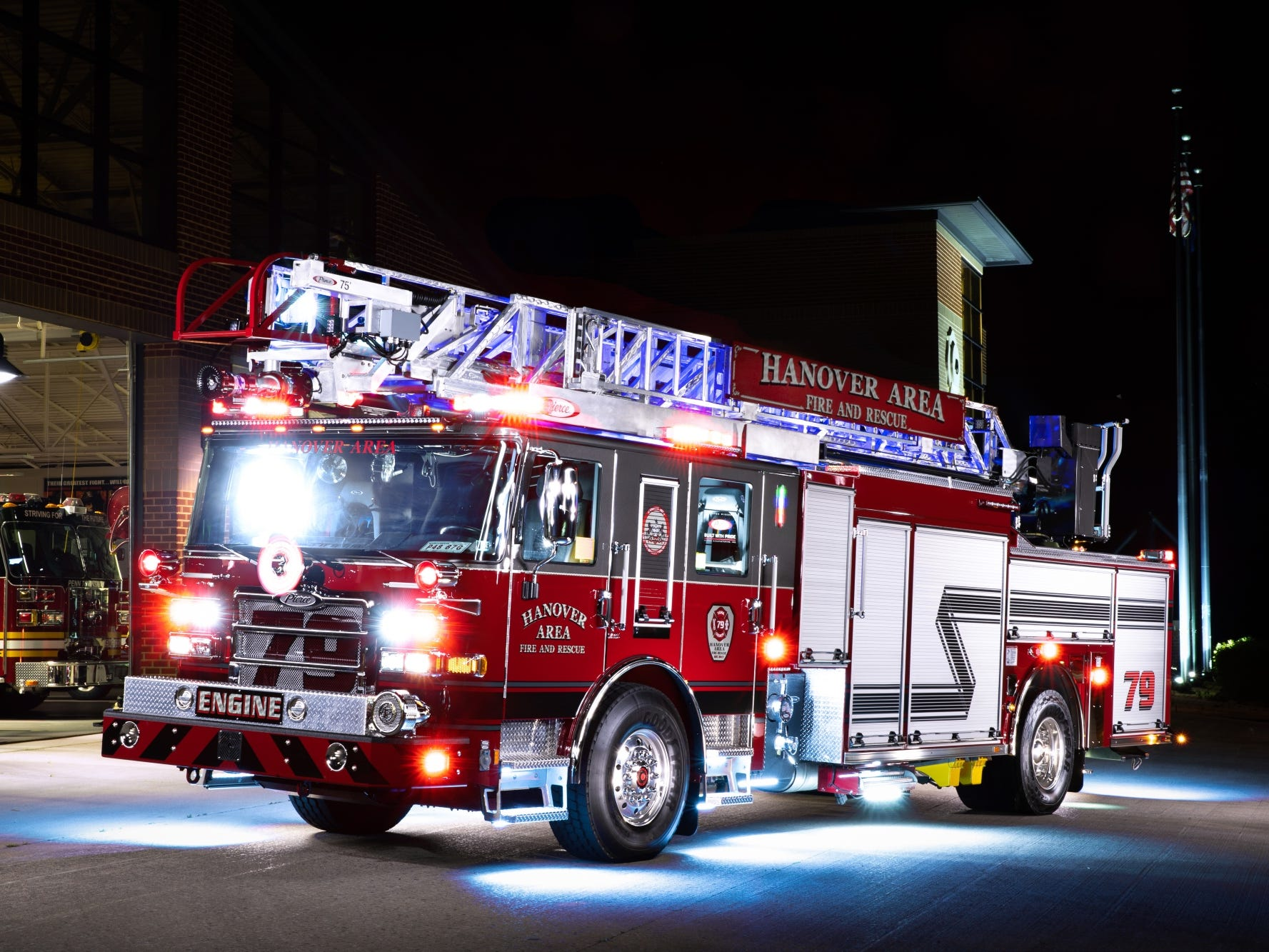 "In a composite ""light painting"" image created from stitching together 16 images in which a LED light was shined across portions of the image, Hanover Area Fire & Rescue's new Engine 79-2 sits on display in front of the Clover Lane station, Thursday, June 22, 2018 in Penn Township. The new engine is expected to go into service in early August, according to Hanover Area Fire & Rescue Captain Kevin Adams."