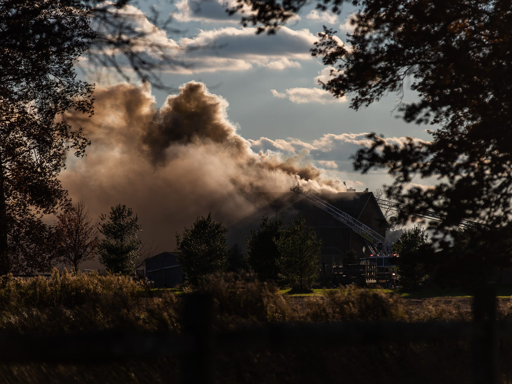 Massive clouds of smoke billow out at the scene of a second-alarm heavily engulfed house fire with entrapment on the 800 block of Two Taverns Road, Saturday, Nov. 3, 2018, in Mount Pleasant Township. Firefighters rescued a young child from the second floor of the house while facing heavy wind-driven fire, said United Hook and Ladder Chief Steve Rabine.