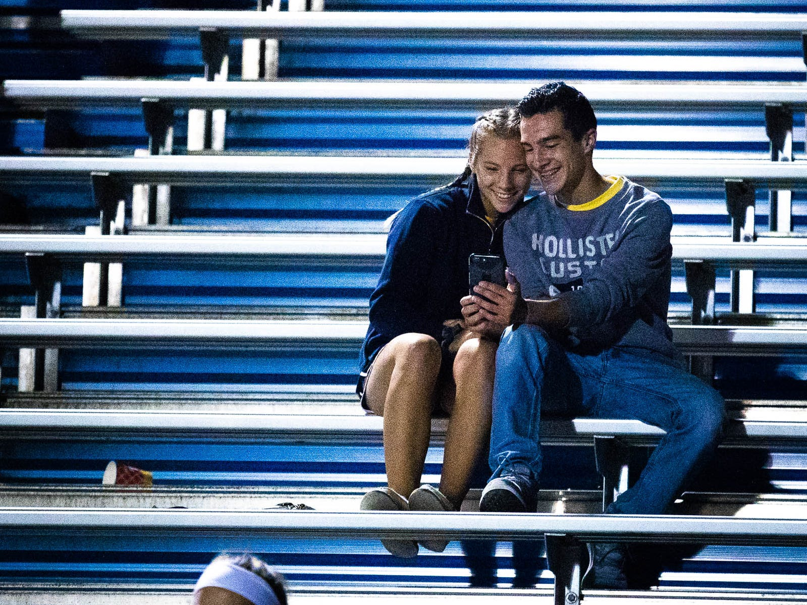 Two Spring Grove fans embrace in the stands during a football game between York High and Spring Grove, Friday, Sept. 21, 2018, in Spring Grove. The York High Bearcats beat the Spring Grove Rockets 55-14.