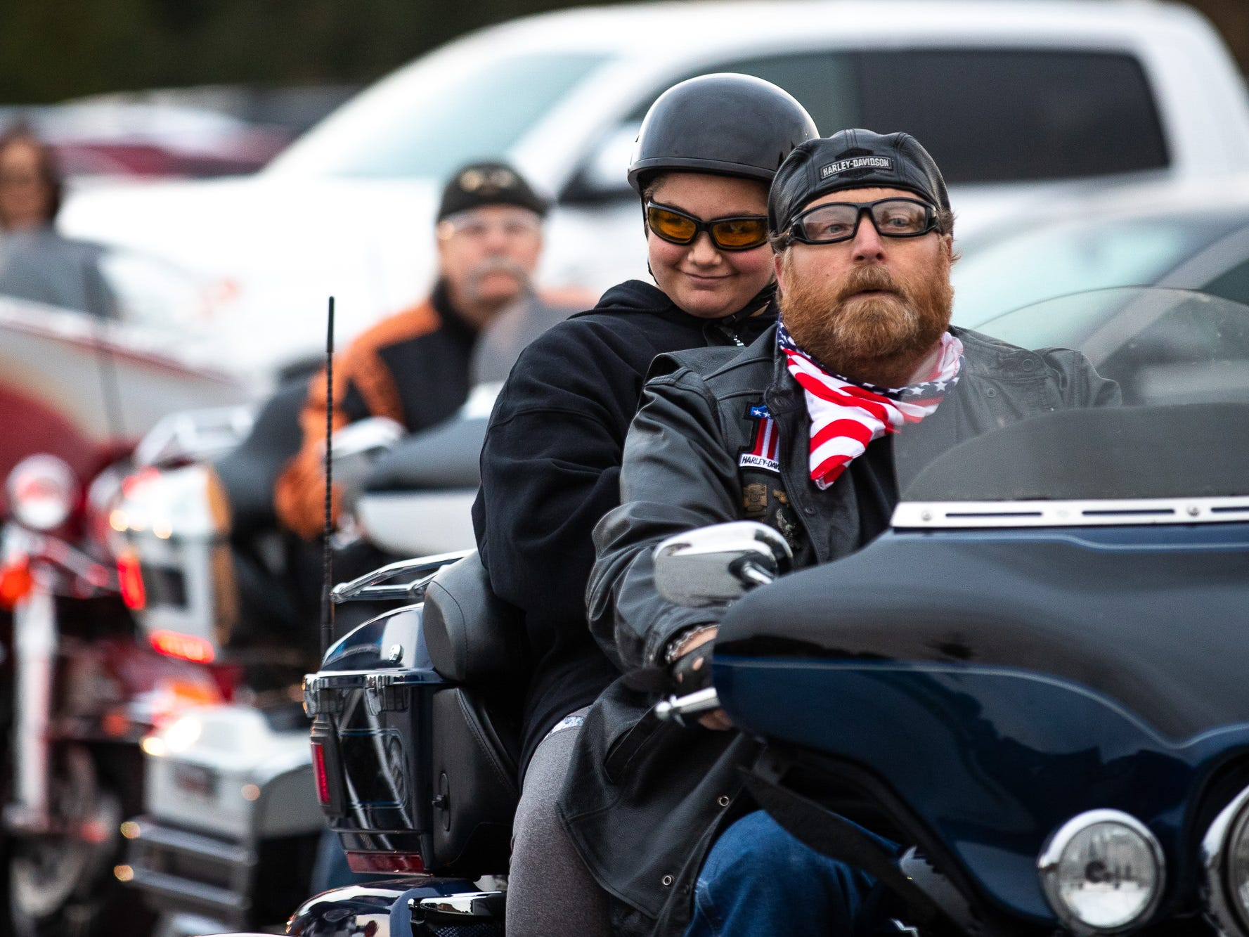 Aireana Mummerth, a 6th grader and victim of bullying, smiles on the back of a bike as she arrives to school at Emory Markle Intermediate escorted by dozens of members of the Alliance of Bikers Aimed Toward Education biker group, Friday, Oct. 5, 2018, in Penn Township. The ride was organized to show their support for Aireana and show that other victims of bullying can find support.