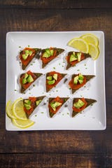 Renowned chef Robin Miller created these smoked salmon and avocado toasts with lemon mixers.