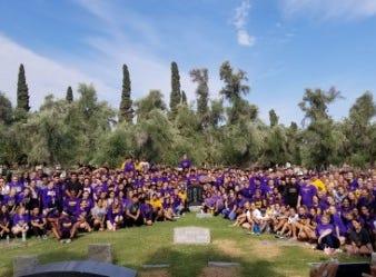 Mesa High School student-athletes pose around Zedo's gravestone.