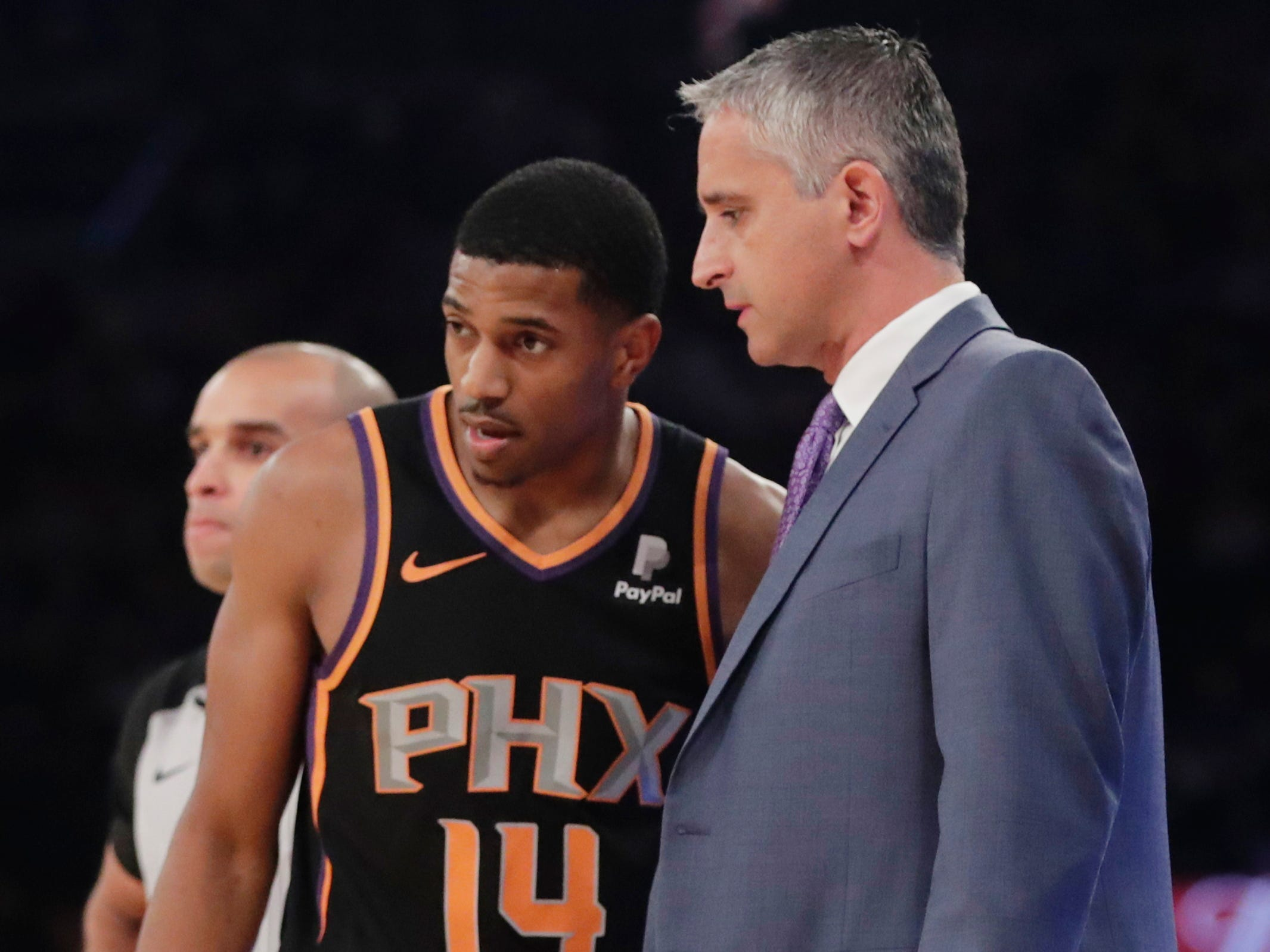 Phoenix Suns head coach Igor Kokoskov, right, talks to Phoenix Suns' De'Anthony Melton (14) during the first half of an NBA basketball game Monday, Dec. 17, 2018, in New York.