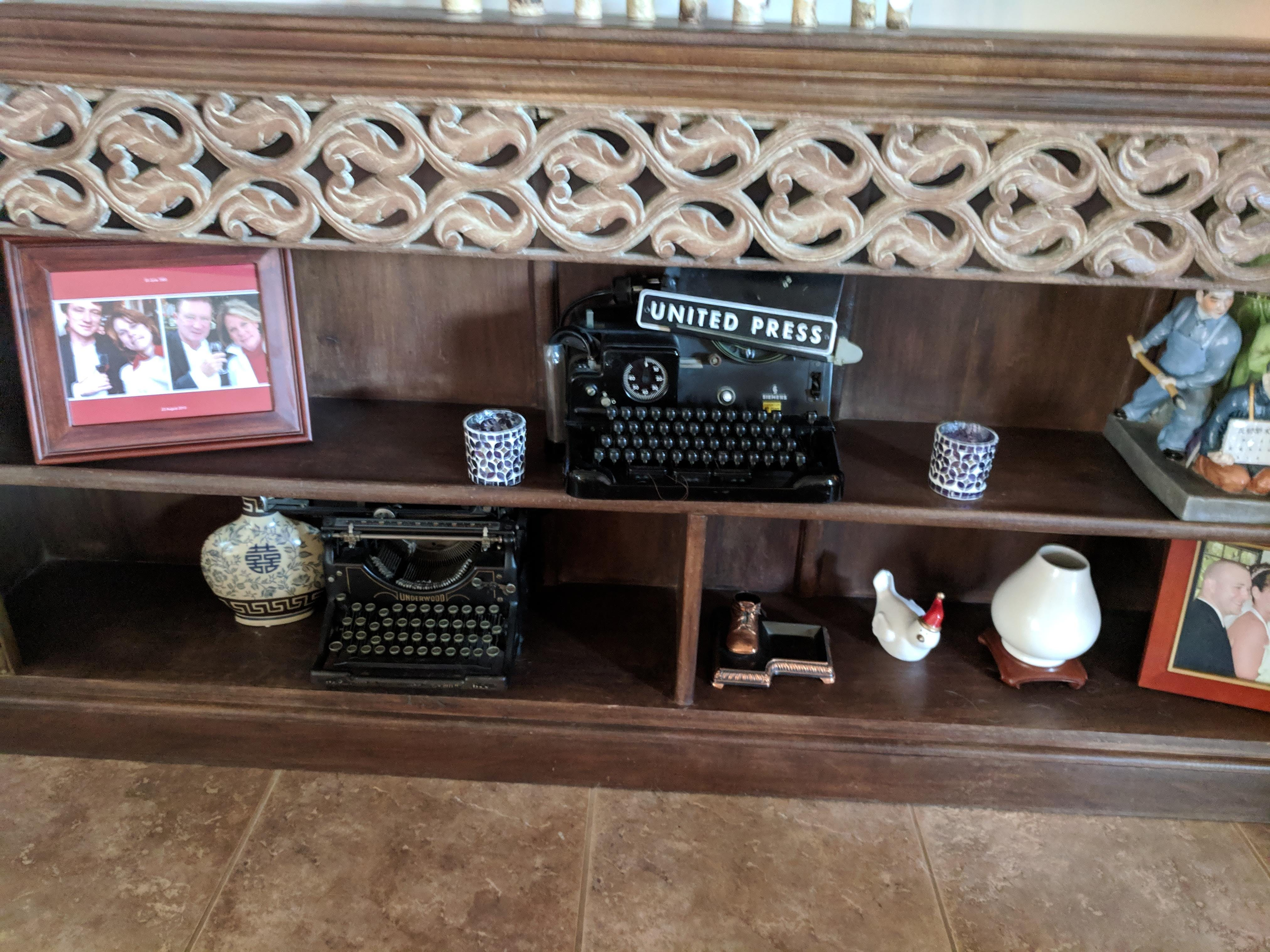 The Reaveses keep their journalism background on display with vintage typewriters in their room.