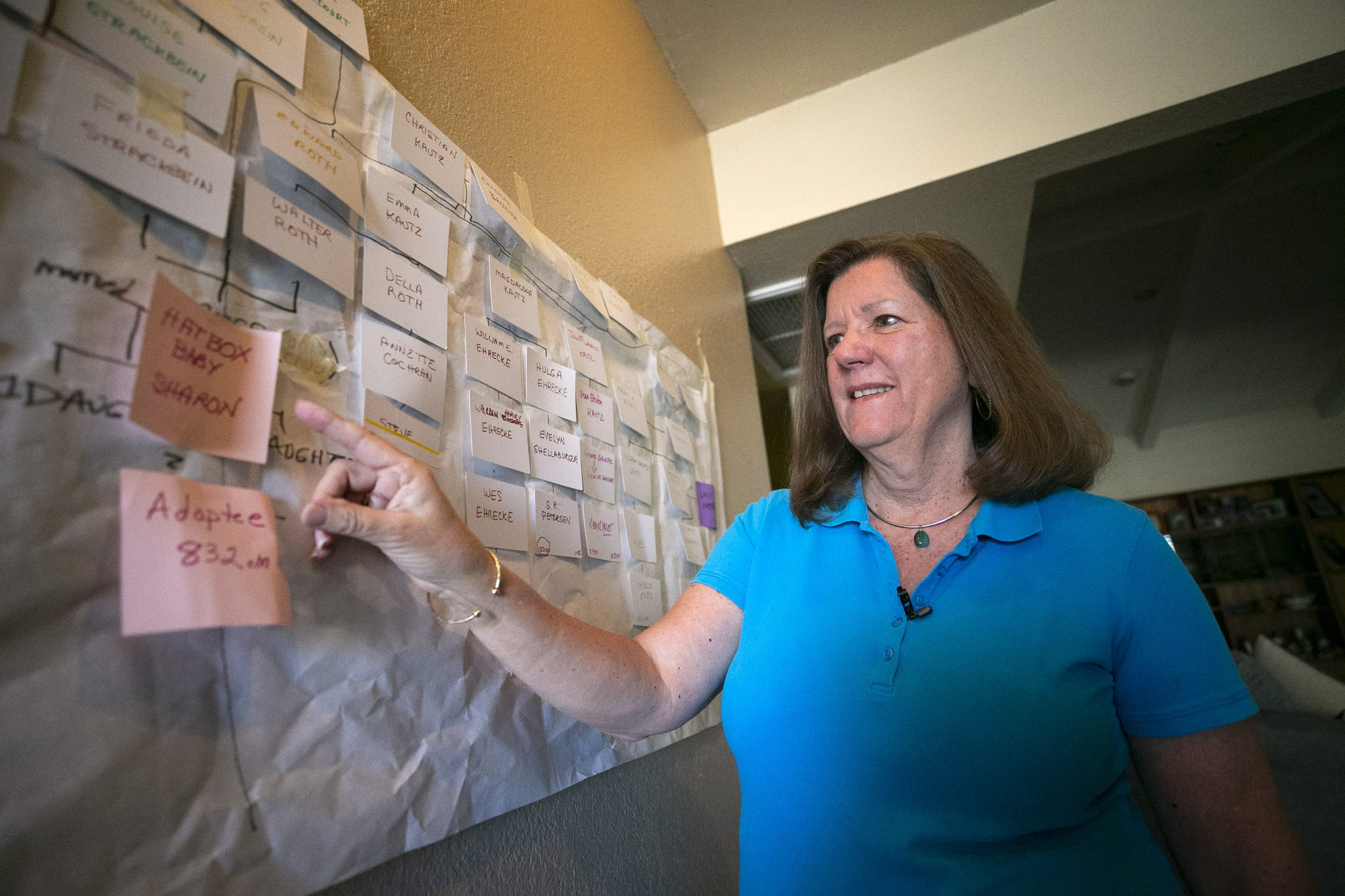 "Bonnie Belza, a DNA specialist and genealogist points to a family tree she made for Sharon Elliott, otherwise known as the ""Hatbox Baby,"" at her home in Scottsdale on Dec. 17, 2018. Using DNA, Belza discovered who Elliott's biological parents were."
