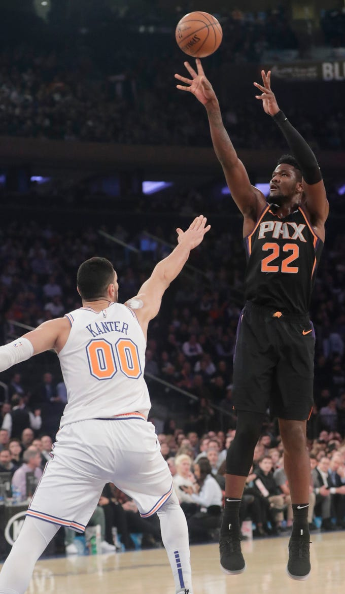 Phoenix Suns' Deandre Ayton (22) shoots over New York Knicks' Enes Kanter (00) during the first half of an NBA basketball game Monday, Dec. 17, 2018, in New York.