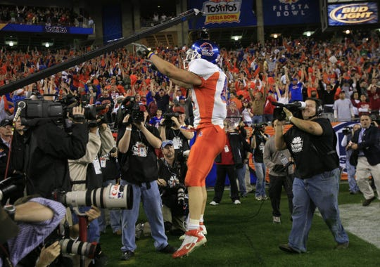 Boise State's Ian Johnson celebrates after scoring a 2-point conversion on a trick play in overtime to defeat Oklahoma during the 2007 Fiesta Bowl.