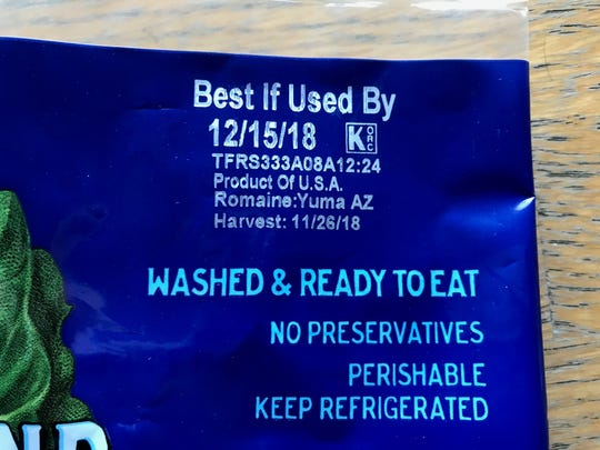 The labeling is shown on a package of romaine lettuce from a Tempe grocery store.