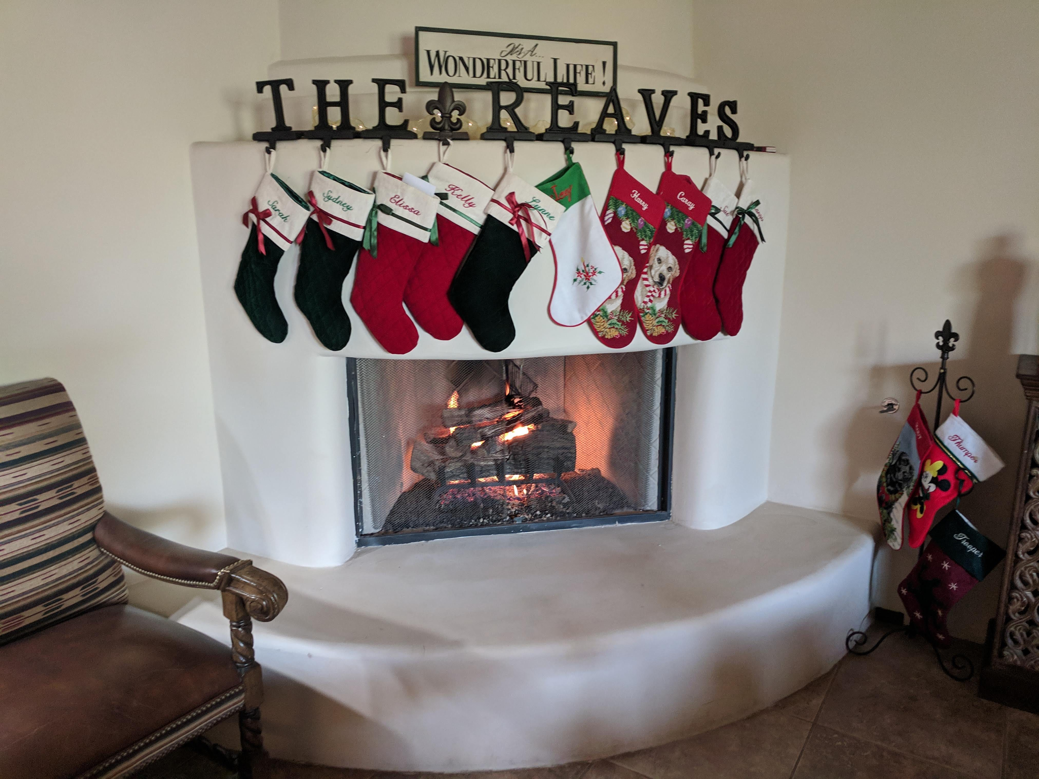 The Reaveses' fireplace, centered in the family room, is ready for Christmas with all of their stockings.