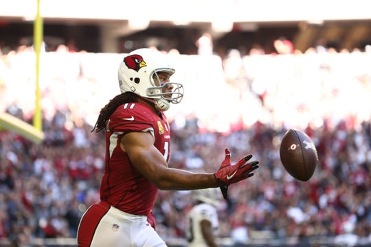 Arizona Cardinals wide receiver Larry Fitzgerald makes a touchdown catch against the Oakland Raiders in the first half during a game on Nov. 18, 2018 at State Farm Stadium.