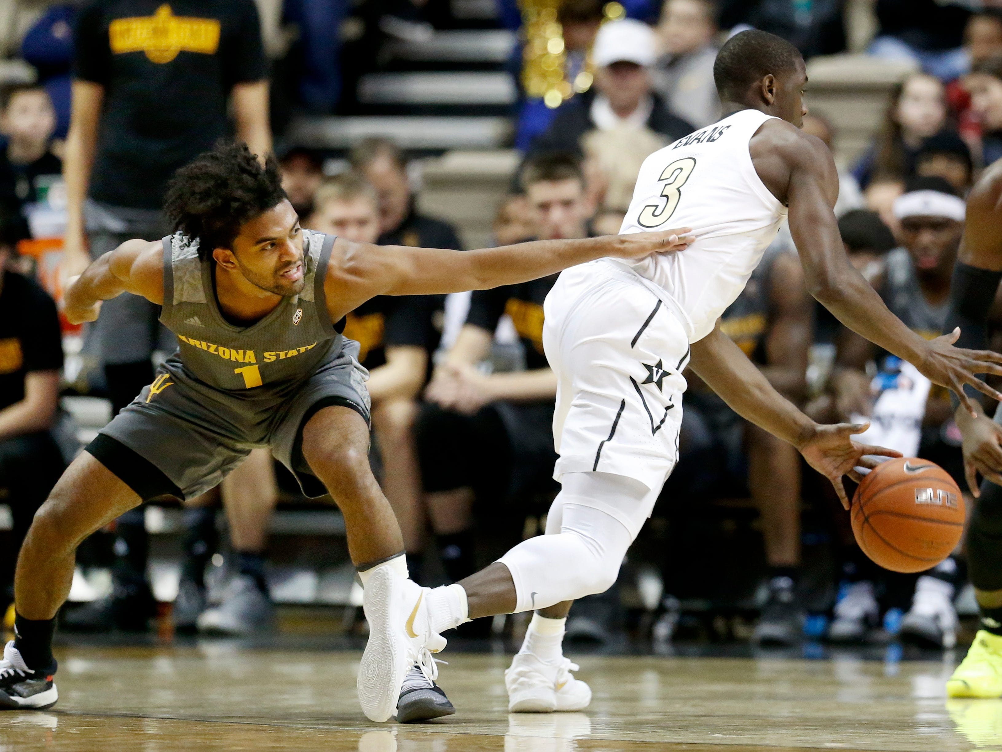 Arizona State guard Remy Martin (1) tries to stop Vanderbilt guard Maxwell Evans (3) in the first half of an NCAA college basketball game Monday, Dec. 17, 2018, in Nashville, Tenn. (AP Photo/Mark Humphrey)