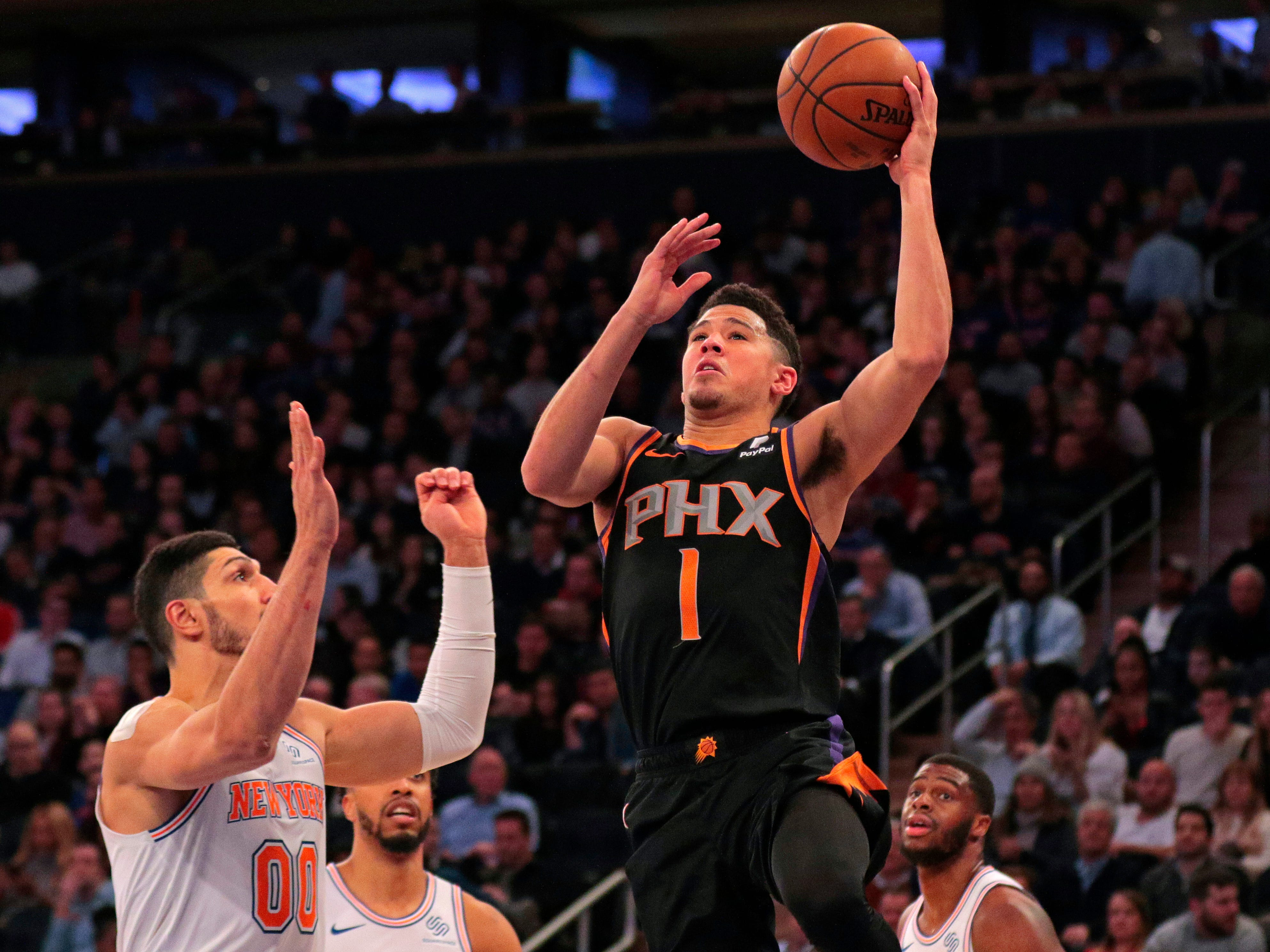Dec 17, 2018: Phoenix Suns guard Devin Booker (1) drives to the basket past New York Knicks center Enes Kanter (00) during the first half at Madison Square Garden.