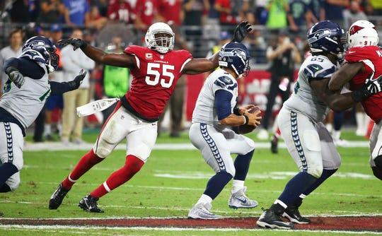 Arizona Cardinals linebacker Chandler Jones sacks Seattle Seahawks quarterback Russell Wilson at State Farm Stadium in Glendale on Sept.30, 2018.