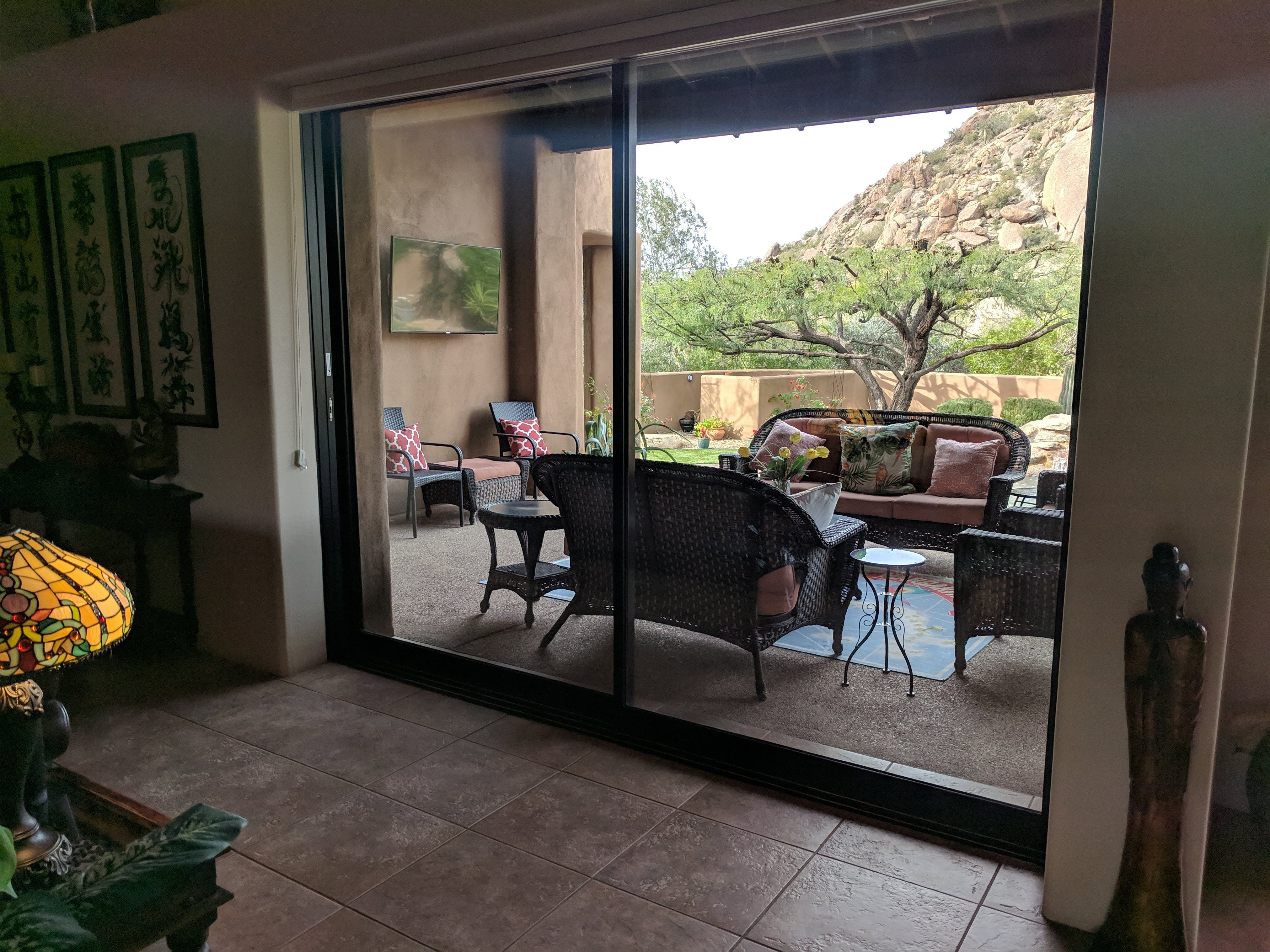Equipped with a fireplace, this patio is the favorite spot for the Reaveses' granddaughter, as it provides a view of the rock formation she named.