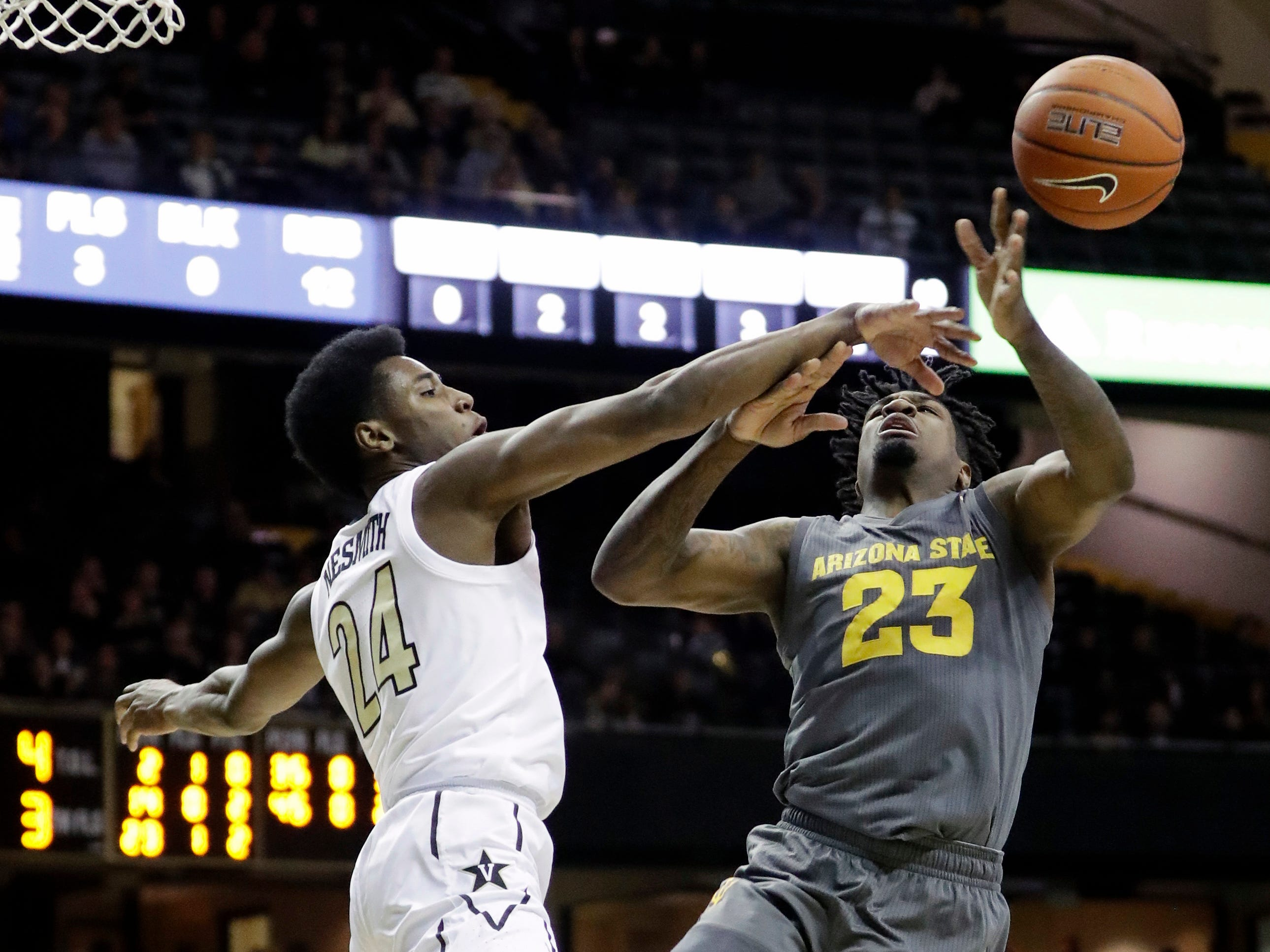 Vanderbilt's Aaron Nesmith (24) knocks the ball away from Arizona State forward Romello White (23) in the first half of an NCAA college basketball game Monday, Dec. 17, 2018, in Nashville, Tenn.