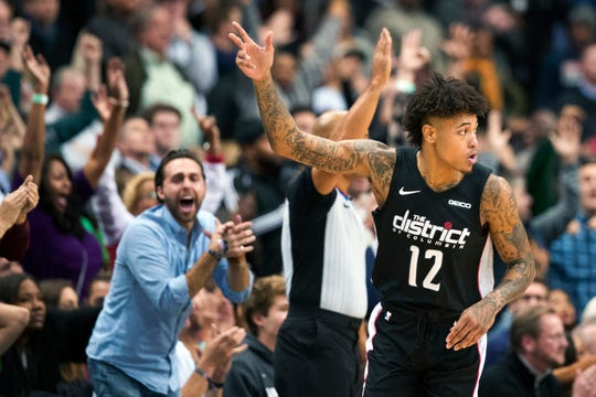 Washington Wizards forward Kelly Oubre Jr. (12) celebrates after a 3-point shot during the overtime period of an NBA basketball game against the Boston Celtics, Wednesday, Dec. 12, 2018, in Washington. The Celtics won 130-125. (AP Photo/Alex Brandon)