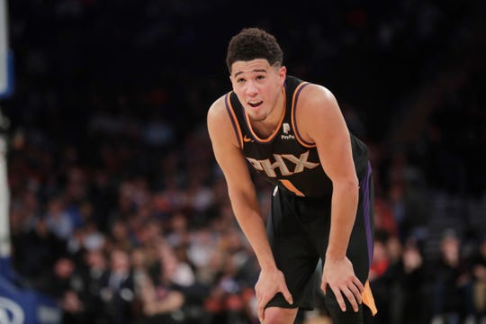 Phoenix Suns' Devin Booker smiles during the second half of an NBA basketball game against the New York Knicks, Monday, Dec. 17, 2018, in New York.