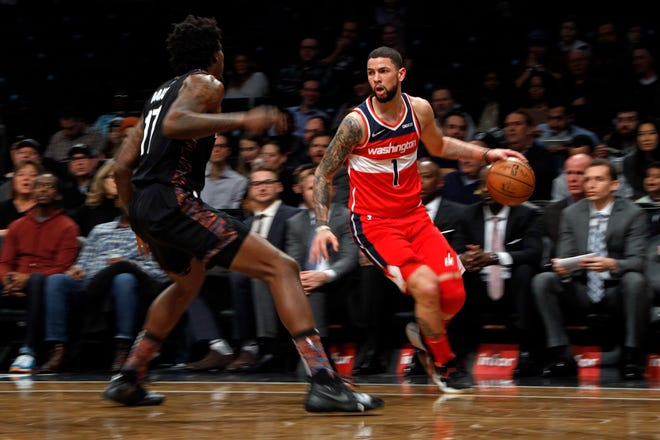 Washington Wizards guard Austin Rivers (1) in action against the Brooklyn Nets during the first half of an NBA basketball game Friday, Dec. 14, 2018, in New York. (AP Photo/Adam Hunger)