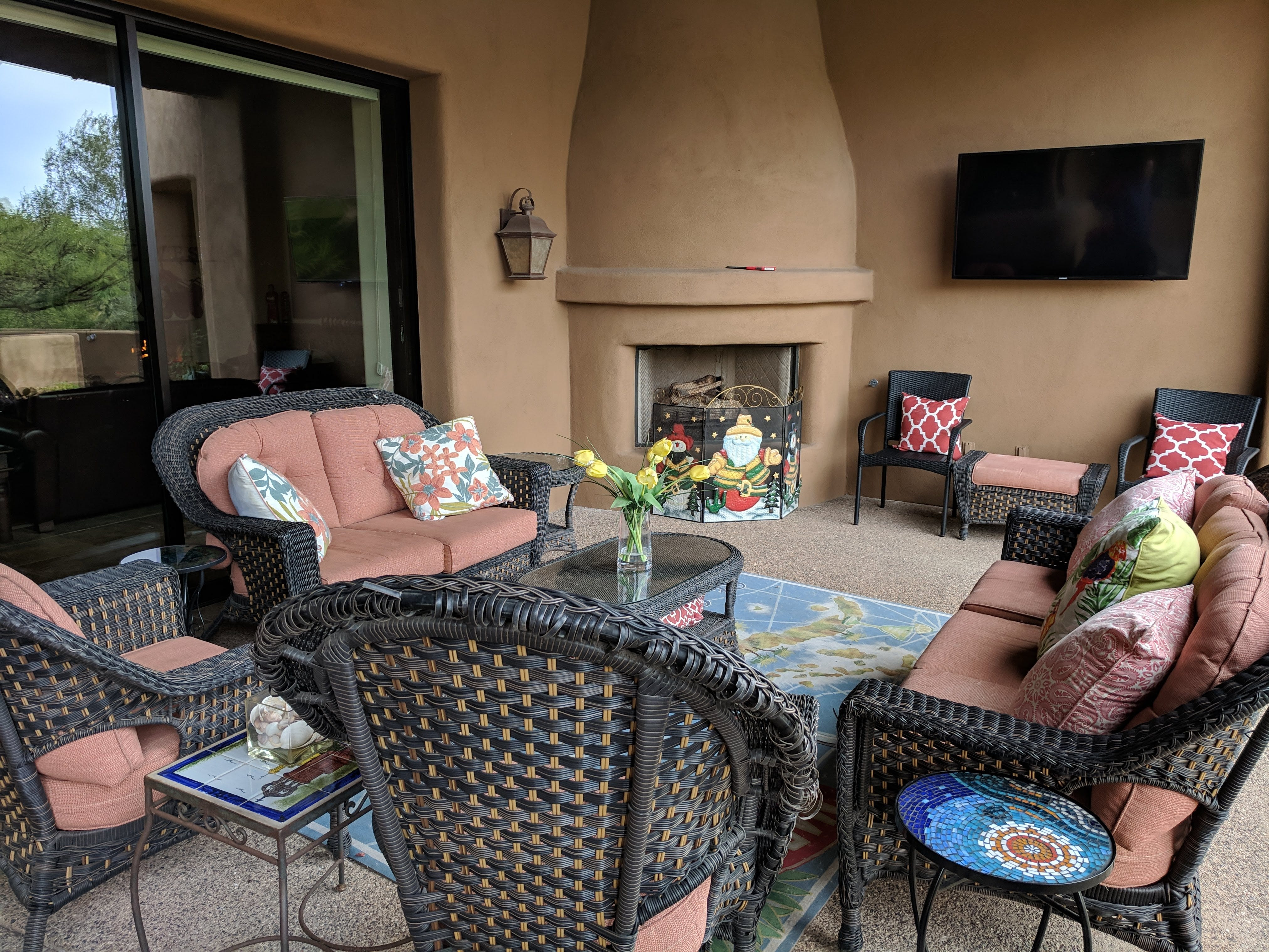 Equipped with a fireplace, this patio is the favorite spot for the Reaves' granddaughter as it provides a view of the rock formation she named.