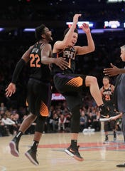 Devin Booker and Deandre Ayton celebrate during a victory over the Knicks on Dec. 17 at Madison Square Garden.