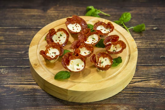 Renowned chef Robin Miller created these salami cups with bocconcini and basil.