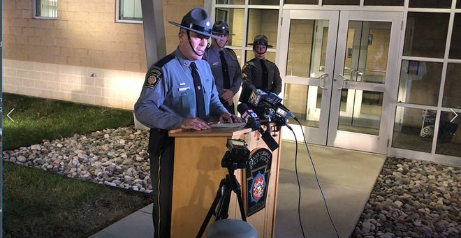 State Police Captain Gary Carter reads a prepared statement during the evening of December 18 at the Jonestown Barracks, describing a police-involved shooting in East Hanover Township, Lebanon County.