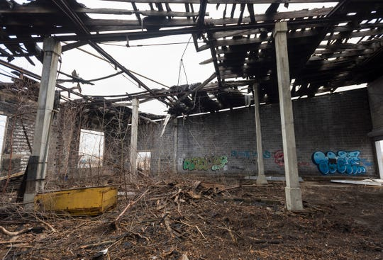 The ceiling has collapsed and nature has started to reclaim the bays of the 98-year-old CSX railroad roundhouse in Port Huron Township. Initial plans were to demolish the structure, but the company has changed its plans after hearing from concerned citizens.