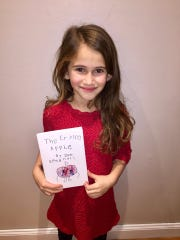 "Zoe Spagnoli, 6, wrote and illustrated a picture book ""The Crying Apple."" She is donating all proceeds of the book to the Pleasant Valley Free Library."